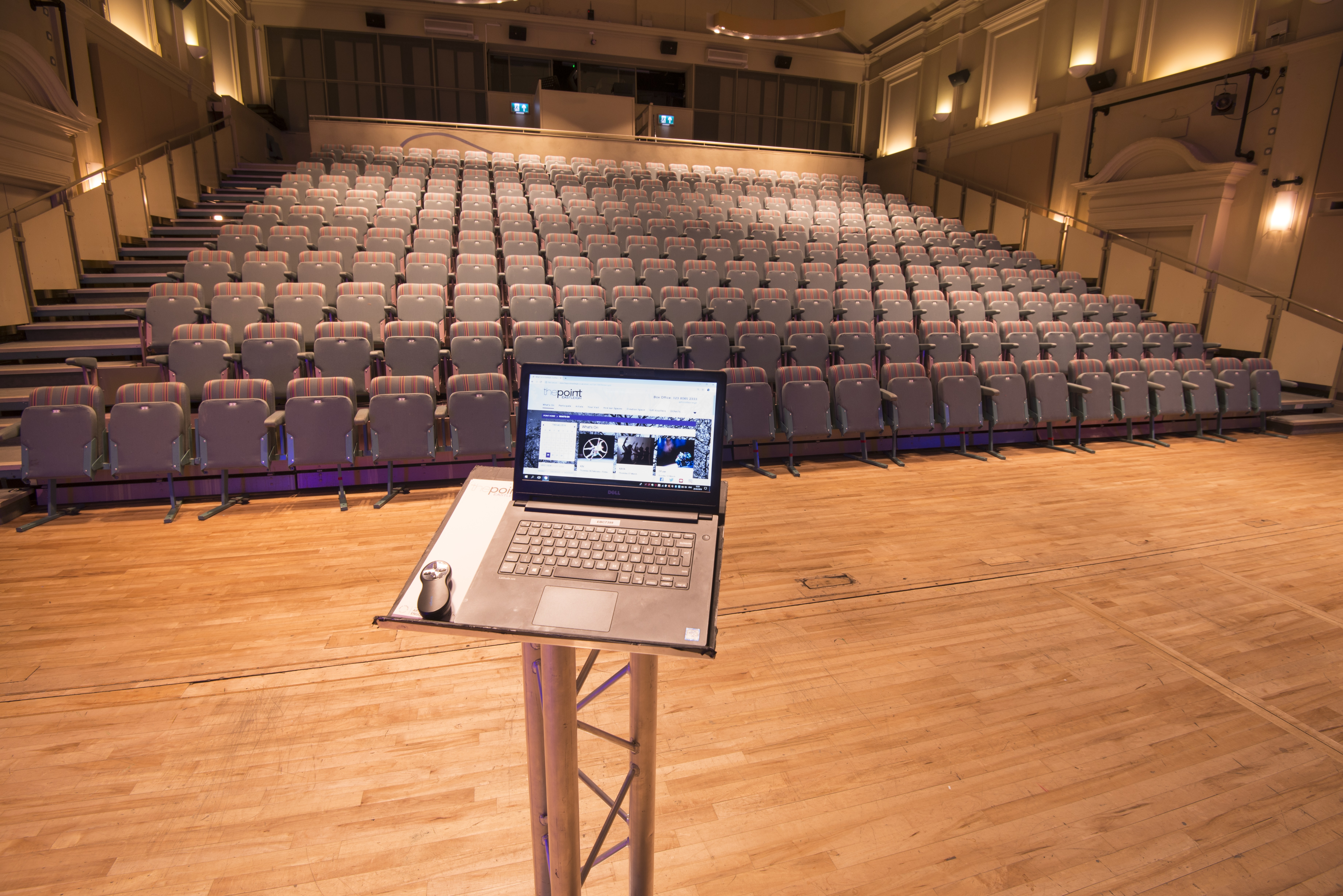 Laptop on stand in front of main auditorium seating