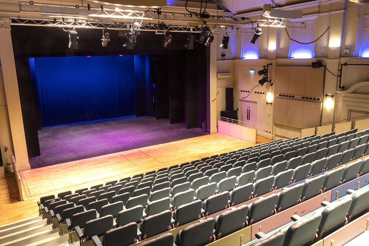 View of seating and stage in main auditorium from stairway